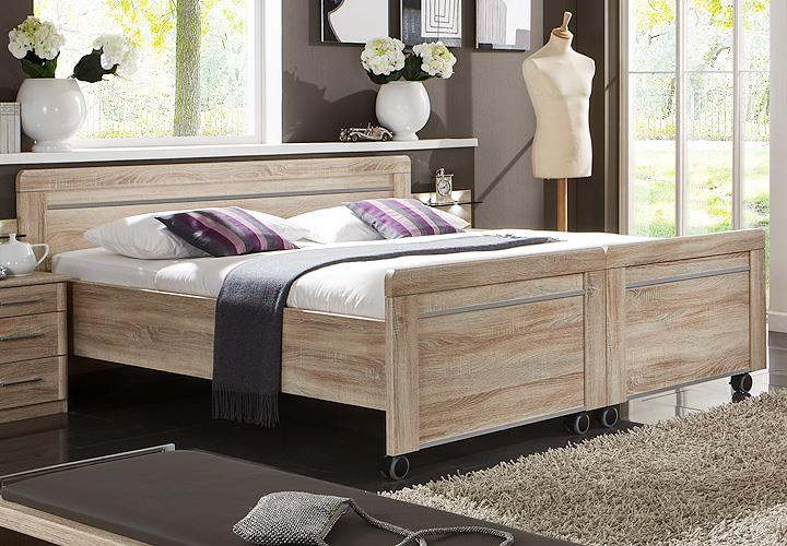 bett meran doppelbett bettgestell auf rollen in eiche. Black Bedroom Furniture Sets. Home Design Ideas